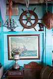 EXUMA, Bahamas. Interior of the Staniel Cay Yacht Club. Dining room and assorted maritime memorablilia.
