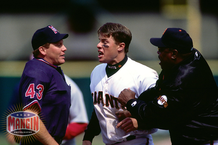 SAN FRANCISCO, CA - J.T. Snow of the San Francisco Giants argues with umpire Paul Schrieber and is held back by manager Dusty Baker during a game in 1999 at Candlestick Park in San Francisco, California. (Photo by Brad Mangin)