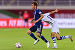 Takashi Inui of Japan (L) competes for the ball with Dostonbek Khamdamov of Uzbekistan (R) during the AFC Asian Cup UAE 2019 Group F match between Japan (JPN) and Uzbekistan (UZB) at Khalifa Bin Zayed Stadium on 17 January 2019 in Al Ain, United Arab Emirates. Photo by Marcio Rodrigo Machado / Power Sport Images