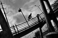 Steven Mantilla, a freerunner from Tamashikaze team, jumps over the footbridge railing during a parkour training session in Bogotá, Colombia, 13 March 2016. Parkour, originally developed in France during the late 1980s from military training, is a physical activity, focused on the art of movement and overcoming obstacles in a strictly urban environment. Practitioners of parkour employ running, climbing, jumping, rolling and other movements to pass through any urban area the most efficient way possible.