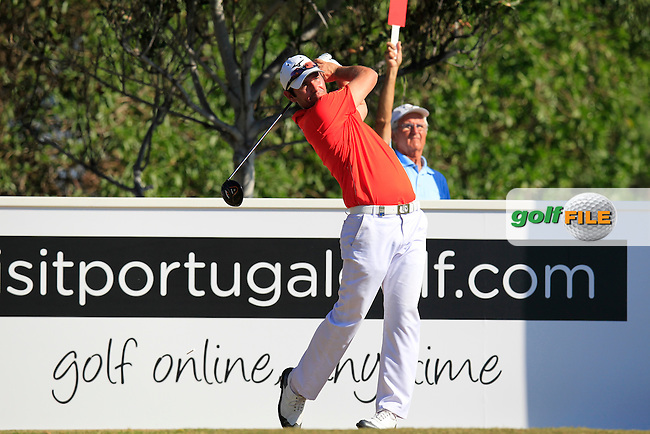 Peter Whiteford (ENG) tees off the 9th tee during Friday's Round 2 of the 2013 Portugal Masters held at the Oceanico Victoria Golf Club. 11th October 2013.<br /> Picture: Eoin Clarke www.golffile.ie