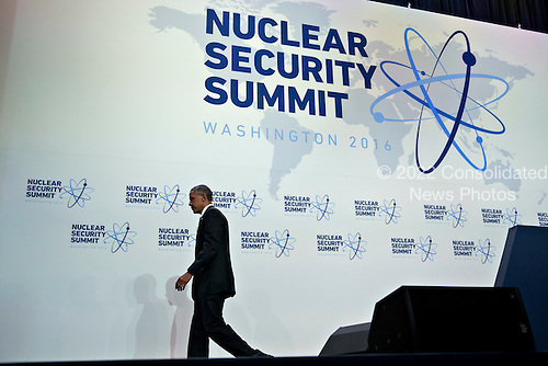 United States President Barack Obama walks off-stage after speaking during a news conference at the Nuclear Security Summit in Washington, D.C., U.S., on Friday, April 1, 2016. After a spate of terrorist attacks from Europe to Africa, Obama is rallying international support during the summit for an effort to keep Islamic State and similar groups from obtaining nuclear material and other weapons of mass destruction. <br /> Credit: Andrew Harrer / Pool via CNP