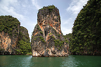 Phang Nga Bay Ao Phang Nga as it is known in Thai is a vast inland sea within the Andaman Sea that lies between the island of Phuket and the mainland of the  of southern Thailand. The bay has been protected as the Ao Phang Nga National Park. Limestone cliffs, cave systems and archaeological sites are found all around Phang Nga Bay. The most famous of the many islands in the bay is James Bond Island, a  limestone rock in the sea, which featured in the movie The Man with the Golden Gun.