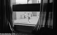Kids out playing, Wester Hailes, Scotland, 1979.  John Walmsley was Photographer in Residence at the Education Centre for three weeks in 1979.  The Education Centre was, at the time, Scotland's largest purpose built community High School open all day every day for all ages from primary to adults.  The town of Wester Hailes, a few miles to the south west of Edinburgh, was built in the early 1970s mostly of blocks of flats and high rises.