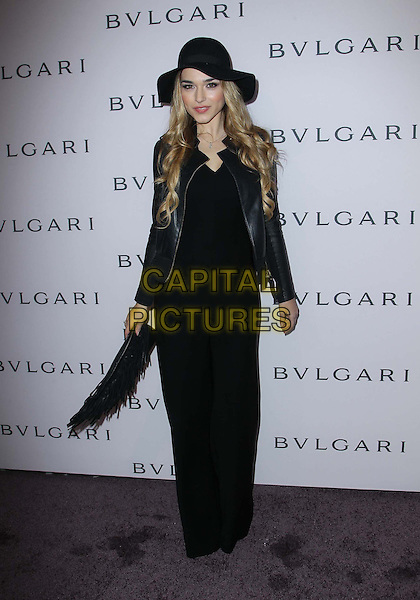 Emanuela Postacchini.BVLGARI celebrates Elizabeth Taylor's magnificent collection of BVLGARI jewelry held at the BVLGARI store, Beverly Hills, California, USA..February 19th, 2013.full length black jumpsuit trousers top leather jacket hat clutch bag .CAP/ADM/FS.©Faye Sadou/AdMedia/Capital Pictures.