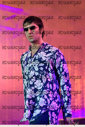 Oasis - vocalist Liam Gallagher - performing live on stage at Rock In Rio III in front of 250,000 people - Rio de Janeiro, Brazil - 14 Jan 2001.  Photo credit: George Chin/IconicPix