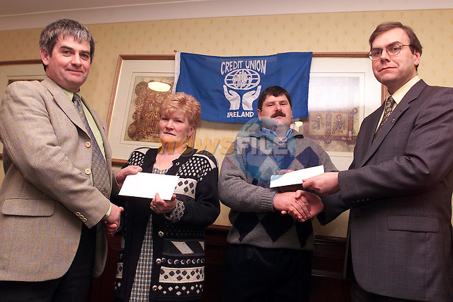 Michael Dowd, secetary Dunleer parish credit union and Thomas fitzpatrick, manager presenting prizes to Imelda Graves and John Brennan, winners of the International Credit Union Day draw..Picture: Paul Mohan/Newsfile