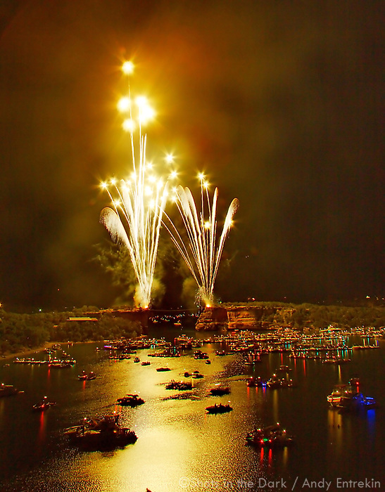 Twin fountains from either side of Hell's Gate signal the start of Lone Star Fireworks Production's 2009 Independence Day show at Possum Kingdom Lake