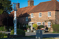 Quaint traditional old-world village of Biddenden in Kent and village sign in England, United Kingdom