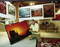 "Tucson Photographer Ray Manley---""Sunrise: The Mittens, Monument Valley, in his gallery 2425 E. Fort Lowell Road...."