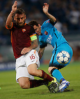 Barcellona's Lionel Messi and  AS Roma's  fight for the ball during the Champions League Group E soccer match   at the Olympic Stadium in Rome September 16, 2015