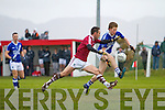 Aidan Walsh for St Mary's with the ball as Dromid's Declan O'Sullivan closes in.