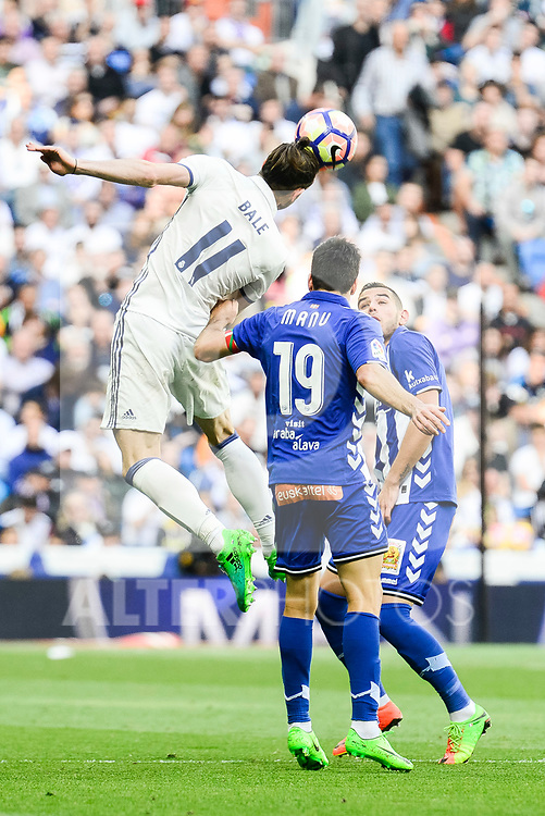 Real Madrid's Gareth Bale and Deportivo Alaves's Manuel Alejandro Garcia during La Liga match between Real Madrid and Deportivo Alaves at Stadium Santiago Bernabeu in Madrid, Spain. April 02, 2017. (ALTERPHOTOS/BorjaB.Hojas)