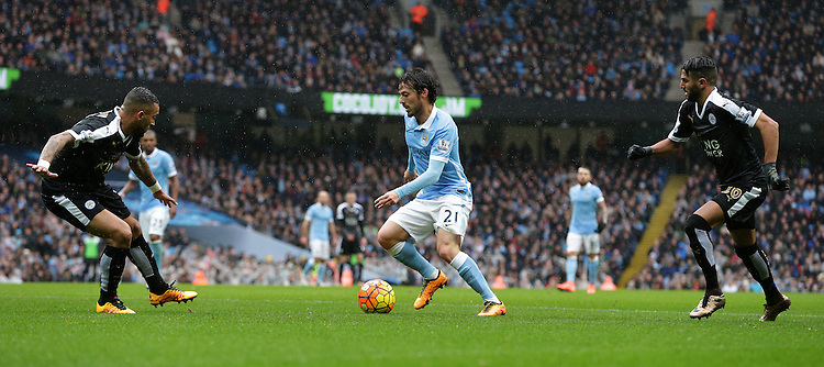 Manchester City's David Silva flanked by Leicester City's Danny Simpson (left) and Riyad Mahrez (right)<br /> <br /> Photographer Stephen White/CameraSport<br /> <br /> Football - Barclays Premiership - Manchester City v Leicester City - Saturday 6th February 2016 -  Etihad Stadium - Manchester<br /> <br /> &copy; CameraSport - 43 Linden Ave. Countesthorpe. Leicester. England. LE8 5PG - Tel: +44 (0) 116 277 4147 - admin@camerasport.com - www.camerasport.com