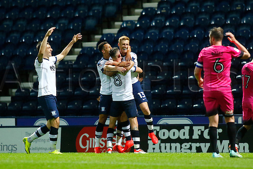 09.08.2016. Deepdale, Preston, England. Football League Cup 1st Round. Preston North End versus Hartlepool. Preston North End striker Eóin Doyle (13) is congratulated by his team mates after scoring his team's winning goal in added time.