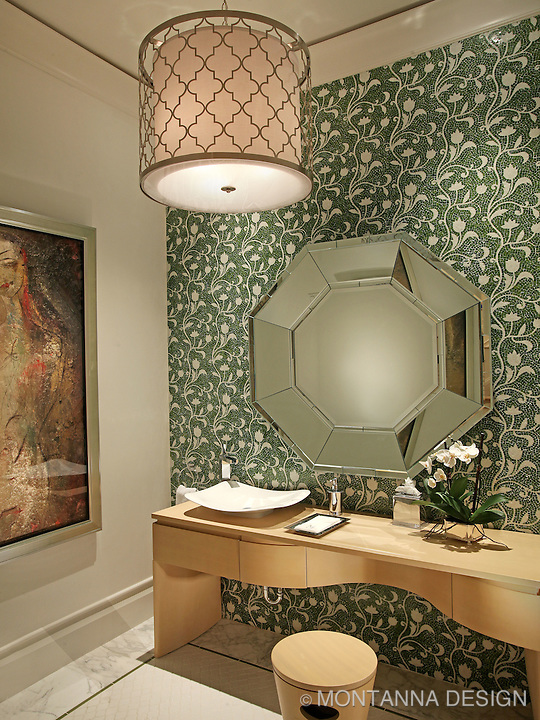 The formal powder bath has mosaic tiled walls with a modern vanity