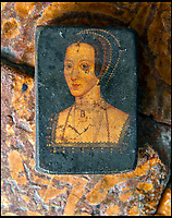 BNPS.co.uk (01202 558833)<br /> Pic: PhilYeomans/BNPS<br /> <br /> The Binney families minature painting of Anne Boleyn, after Holbein, on unearthed Tudor tiles on which she may have walked.<br /> <br /> Historic Wolf Hall, home to the Seymour family and star of Hilary Mantel's famous trilogy on Henry VIII th, has finally been definitively located after new discoveries around the much smaller ramshackle house that remains today. <br /> <br /> Despite it's fame, nobody really knew where the enormous Tudor pile actually was, or what it looked like, due to its very short but very influential existance in the middle of the tumultuous 16th century.<br /> <br /> Built with a million pound loan (&pound;2,400) from King Henry in 1531, brokered by Thomas Cromwell, the huge house was rapidly brick built in time for the King's pivotal visit with the court and troublesome wife Anne Boleyn in 1535, at which point Sir John Seymour's daughter Jane caught his eye, within a year Anne was dead and Jane, and the rest of the Seymour clan were in.<br /> <br /> They benefitted massively from Royal patronage and the dissolution of the monastries, but it all went wrong when Henry died and the brothers fell out and were later executed in a spectacular fall from power only 21 years after the house was built.<br /> <br /> Historian Graham Bathe and his team have now uncovered part of the outline of the original building, as well as the extensive Tudor brick sewer system that proves the huge scale of the 16th century mansion.