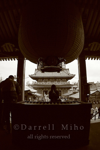 Mar 6, 2006; Tokyo, JPN; Asakusa.Visitors toss coins in the wooden coffer (front) and pray at the Senso-ji Buddhist temple.  The Hozo-mon (treasure gate) can be seen  in the background...Photo credit: Darrell Miho