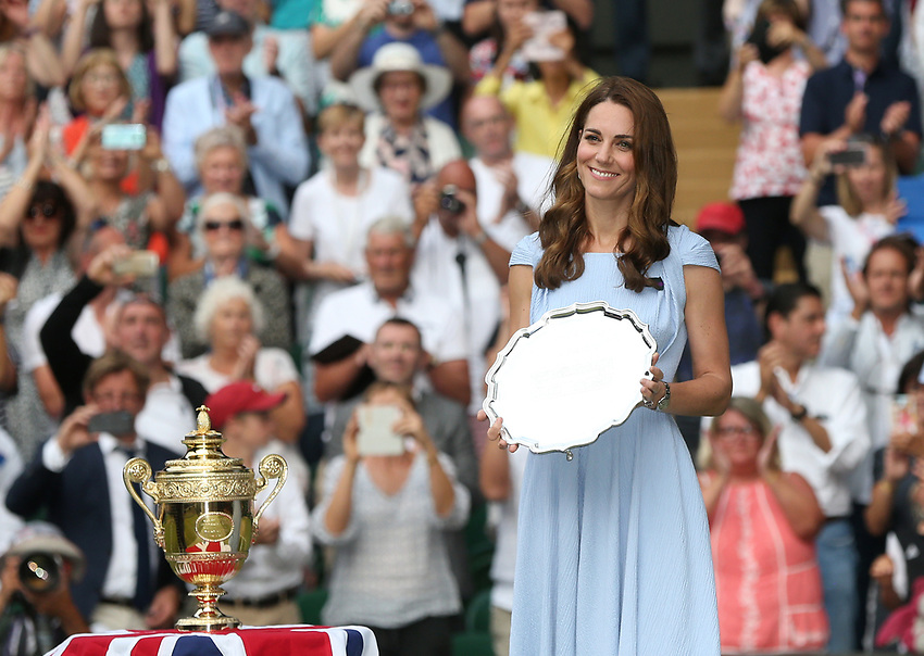 Roger Federer of Switzerland is about to be presented with the runners-up trophy by Catherine, Duchess of Cambridge<br /> <br /> <br /> Photographer Rob Newell/CameraSport<br /> <br /> Wimbledon Lawn Tennis Championships - Day 13 - Sunday 14th July 2019 -  All England Lawn Tennis and Croquet Club - Wimbledon - London - England<br /> <br /> World Copyright © 2019 CameraSport. All rights reserved. 43 Linden Ave. Countesthorpe. Leicester. England. LE8 5PG - Tel: +44 (0) 116 277 4147 - admin@camerasport.com - www.camerasport.com