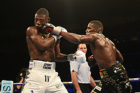 Lawrence Okolie (black shorts) defeats Isaac Chamberlain during a Boxing Show at The O2 on 3rd February 2018