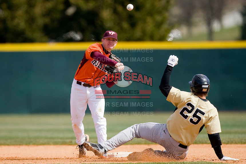 Second baseman Michael Seaborn #5 of the Virginia Tech Hokies fires to first to complete a double play as Matt Conway #25 of the Wake Forest Demon Deacons attempts to break it up at English Field March 27, 2010, in Blacksburg, Virginia.  Photo by Brian Westerholt / Four Seam Images