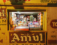 Forty-year-old Mrs. Tara with her son, eighteen-year-old Rahul, in their small grocery shop, which opens from 7am to 11pm. Mrs. Tara hopes that her son will take over the shop in the future. CHECK with MRM/FNA