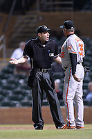 Manager Gary Kendall (35) argues a call with home plate umpire Jeff Morrow during an Arizona Fall League game between the Salt River Rafters and Surprise Saguaros on October 15, 2013 at Salt River Fields at Talking Stick in Scottsdale, Arizona.  Surprise defeated Salt River 9-2.  (Mike Janes/Four Seam Images)