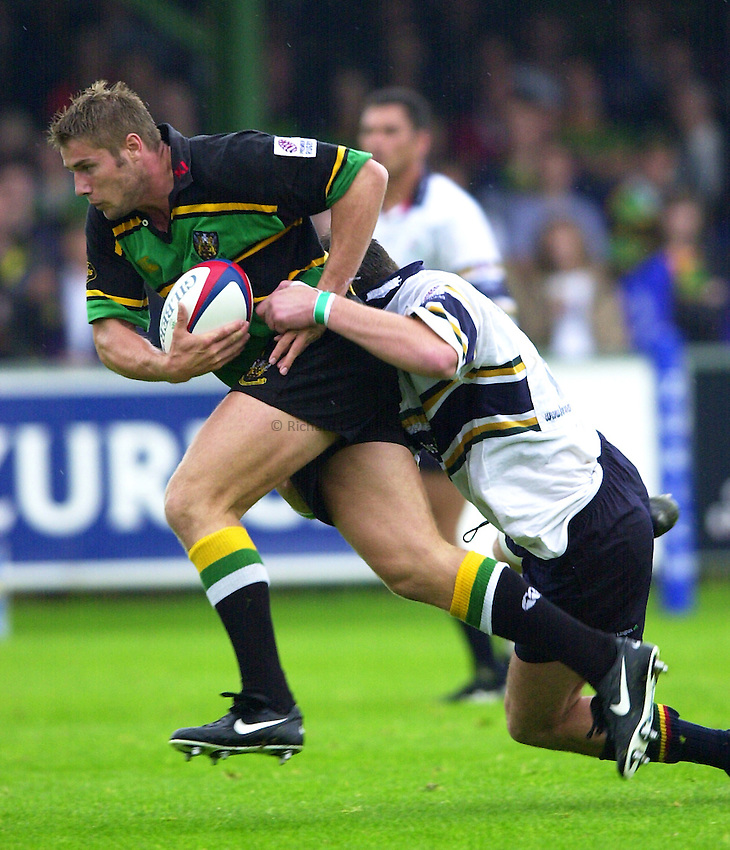 Photo. Richard Lane. .Northampton v London Irish. Zurich Premiership. 26/8/2000..Ben Cohen breaks past Eddie Halley.