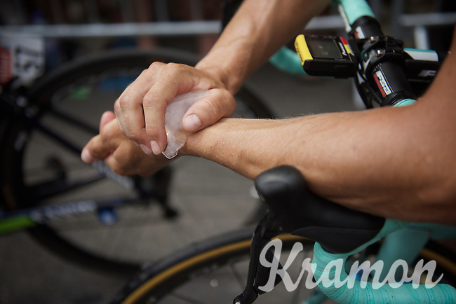 As it is yet another hot day in the Tour, Sep Vanmarcke (BEL/LottoNL-Jumbo) tries to keep cool by rubbing ice against his wrists before the stage start<br /> <br /> stage 14: Rodez - Mende (178km)<br /> 2015 Tour de France