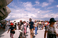 July 1976 File Photo - A crowd walk through the Montreal Olympic village during the 1976 Olympics (velodrome in background and stadium on the left)