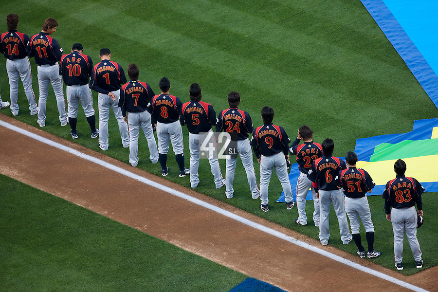 23 March 2009: Players of team Japan stand during the national anthem prior to the 2009 World Baseball Classic final game at Dodger Stadium in Los Angeles, California, USA. Japan defeated Korea 5-3