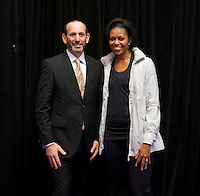 First Lady Michelle Obama stands with MLS Commissioner and US Soccer Foundation board member Don Garber during a US Soccer Foundation clinic held at City Center in Washington, DC.
