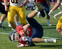 Central Bucks East's Tyler Ellixson (85) rolls onto the ground after an interception against Central Bucks West in the third quarter Saturday, October 21, 2017 at Central Bucks East in Buckingham, Pennsylvania. (WILLIAM THOMAS CAIN / For The Philadelphia Inquirer)