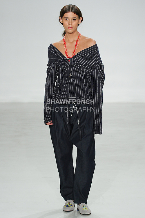 Model walks runway in a double tie stripe Noragi, and horizontal seerucker como trouser, from the Palmiers du Mal Spring Summer 2017 collection by Brandon Capps and Shane Fonner, at Skylight Clarkson Square on July 14 2016, during New York Fashion Week Men's Spring Summer 2017.