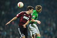 FUSSBALL   1. BUNDESLIGA    SAISON 2012/2013    17. Spieltag   SV Werder Bremen - 1. FC Nuernberg                     16.12.2012 Timm Klose (li, 1. FC Nuernberg) gegen Nils Petersen (re, SV Werder Bremen)