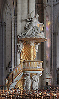 Pulpit of gilded wood designed by Pierre-Joseph Christophle, 1715-1782, and above, an angel sculpture pointing to heaven and holding a book of the law, 1773, by Jean-Baptiste Michel Dupuis, 1698-1780, at the Basilique Cathedrale Notre-Dame d'Amiens or Cathedral Basilica of Our Lady of Amiens, built 1220-70 in Gothic style, Amiens, Picardy, France. Amiens Cathedral was listed as a UNESCO World Heritage Site in 1981. Picture by Manuel Cohen