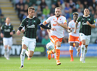 Plymouth Argyle's Gary Sawyer under pressure from Blackpool's Ryan McLaughlin<br /> <br /> Photographer Kevin Barnes/CameraSport<br /> <br /> The EFL Sky Bet League One - Plymouth Argyle v Blackpool - Saturday 15th September 2018 - Home Park - Plymouth<br /> <br /> World Copyright &copy; 2018 CameraSport. All rights reserved. 43 Linden Ave. Countesthorpe. Leicester. England. LE8 5PG - Tel: +44 (0) 116 277 4147 - admin@camerasport.com - www.camerasport.com