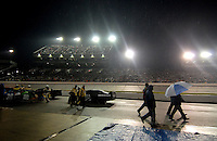 May 5, 2007; Richmond, VA, USA; Nascar Nextel Cup Series crew members leave the grid during a rain delay in the Jim Stewart 400 at Richmond International Raceway. Mandatory Credit: Mark J. Rebilas