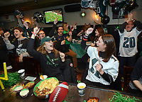 Philadelphia Eagles fans Emily Sax (with cap) of New York and Taylor Durovsik #11 of Philadelphia sing the Eagles fight song at Smith's Bar & Restaurant Sunday, February 04, 2018 in Philadelphia, Pennsylvania. Generally a Patriots hangout, the bar was overridden by Eagles fans singing the Eagles fight song. WILLIAM THOMAS CAIN / For The Inquirer