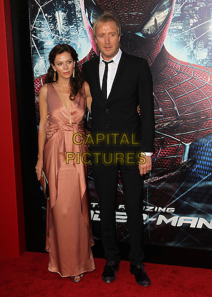 "Anna Friel & Rhys Ifans.Los Angeles Premiere Of ""The Amazing Spider-Man"" Held The at Regency Village Theatre, Westwood, California, USA..June 28th, 2012.full length pink silk satin sleeveless dress gold clutch bag wrap black suit  couple .CAP/ADM/FS.©Faye Sadou/AdMedia/Capital Pictures."