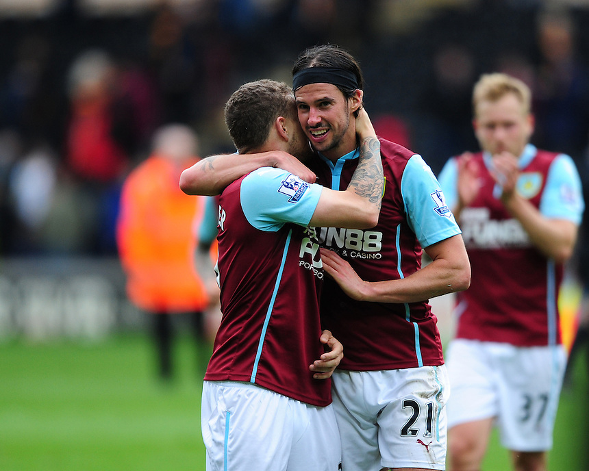 Burnley's Kieran Trippier, left, and Burnley's George Boyd celebrate their 1-0 win over Hull City before it was confirmed they had been relegated from the Premier League<br /> <br /> Photographer: Chris Vaughan/CameraSport<br /> <br /> Football - Barclays Premiership - Hull City v Burnley - Saturday 9th May 2015 - Kingston Communications Stadium - Hull<br /> <br /> &copy; CameraSport - 43 Linden Ave. Countesthorpe. Leicester. England. LE8 5PG - Tel: +44 (0) 116 277 4147 - admin@camerasport.com - www.camerasport.com