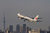 A Boeing 767-346(ER) airliner with Japan Airline (JAL) flies in front of  Tokyo Skytree as it takes-off from Haneda Airport, Tokyo, Japan. Thursday, May 16th 2019
