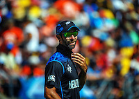 Grant Elliott fields during the ICC Cricket World Cup one day pool match between the New Zealand Black Caps and England at Wellington Regional Stadium, Wellington, New Zealand on Friday, 20 February 2015. Photo: Dave Lintott / lintottphoto.co.nz