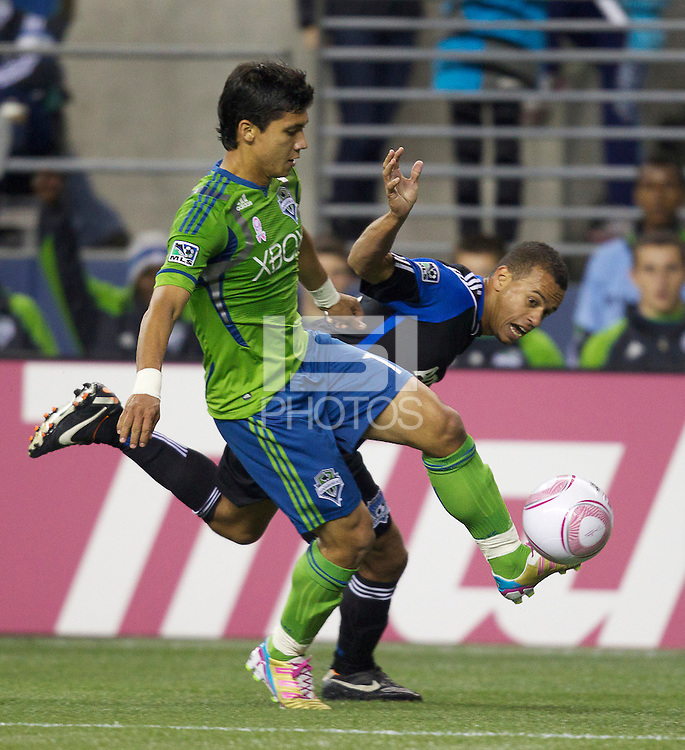 Seattle Sounders FC forward Fredy Montero, left, and San Jose Earthquakes defender Jason Hernandez battle for the ball during play at CenturyLink Field in Seattle Saturday October 15, 2011. The Sounders FC won the game 2-1.
