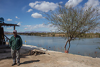 MEXICALI, MEXICO - March 12. Carlos poses for a portrait by the river on March 12, 2019 in Mexicali, Mexico. He runs a tourist business, which has been affected due to lack of water since there are almost no tourists in the area<br /> The rivers usually end in the sea, the Colorado dies in a border. Its the only case like this in the world. There is less water in the Colorado River, hence less water in crops and areas of northern Mexico.  <br /> (Photo by Luis Boza/VIEWpress)