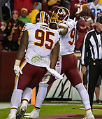 Washington Redskins defensive tackle Da'Ron Payne (95) celebrates with linebacker Preston Smith (94) after Smith scored what proved to be the game-winning touchdown in the fourth quarter against the Dallas Cowboys at FedEx Field in Landover, Maryland on Sunday, October 21, 2018.  The Redskins won the game 20 - 17.<br /> Credit: Ron Sachs / CNP