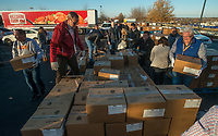 NWA Democrat-Gazette/BEN GOFF @NWABENGOFF<br /> Tyson employees load boxes of frozen chicken onto a trailer Wednesday, Dec. 5, 2018, at the John Q. Hammons Center and Embassy Suites Northwest Arkansas in Rogers. More than 800 Tyson employees from across the country who are in town this week attending the company's annual sales conference took the afternoon to pack and load food donations. The employees helped distribute 35,000 pounds of Tyson products to Northwest Arkansas organizations with feeding services and food banks. In addition 1,000 meal boxes, 15,000 snack packs and personal hygiene kits were packaged and distributed to Northwest Arkansas non-proffits.