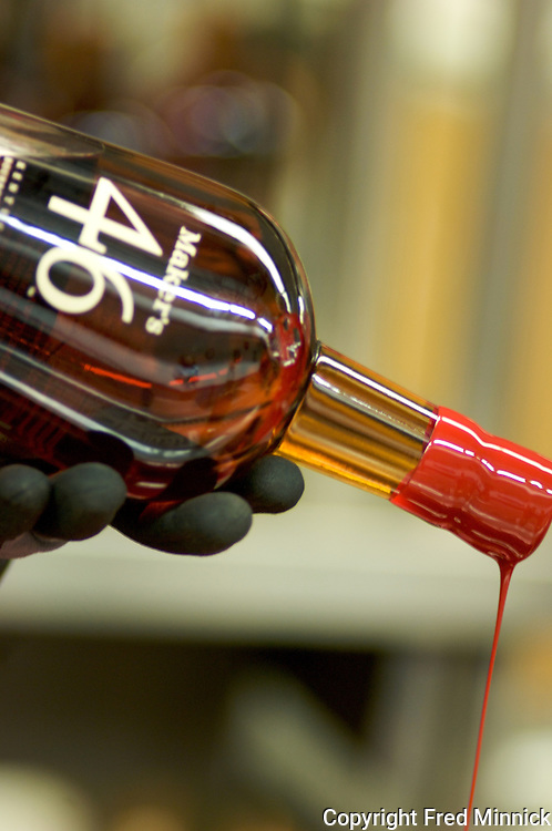 On the first day of its bottling, Maker's Mark 46 is dipped into the traditional red wax Maker's is known for. It's the company's first new product in more than 50 years.