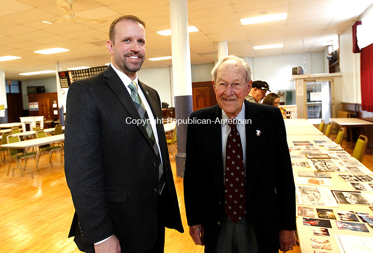 Waterbury, CT- 09 November 2014-110914CM07-  Social moments-- From left to right, St. Joseph alumni, Linas Venclauskas and Anthony Alexander of Torrington, photographed during the St. Joseph Parish 120th anniversary celebration in Waterbury on Sunday.   Christopher Massa Republican-American