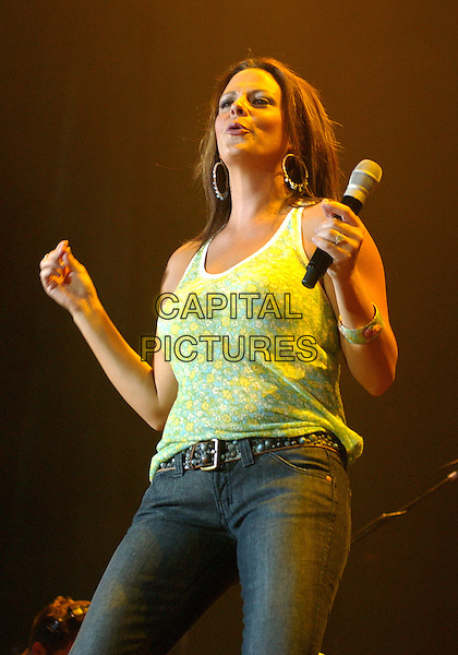 "SARA EVANS.Performs the opening act on Brad Paisley's ""Time Well Wasted Tour"" held at the Post-Gazette Pavilion, Pittsburgh, Pennsylvania, USA..July 7th, 2006.Photo: Jason L Nelson/AdMedia/Capital Pictures.Ref: JN/ADM.live gig performance stage music half length.www.capitalpictures.com.sales@capitalpictures.com.© Capital Pictures."